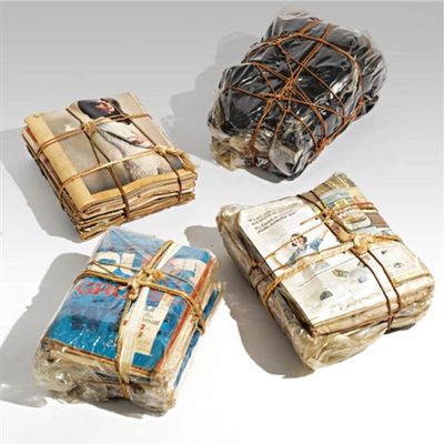 Wrapped magazines & wrapped cloth by Christo